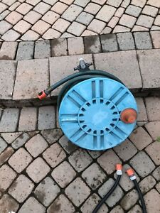 Garden hose and wall mounted reel