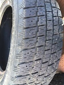 4 tires with lots of use left in them. 195/70R14
