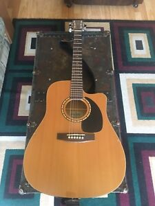 Simon and Patrick Acoustic amplifiable guitar with case.
