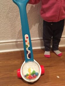 Fisher price corn popper push toy