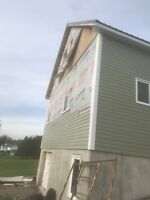 Need someone to finish siding my front and back of the garage.