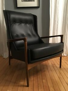 Mid century modern Walnut and Leather wing back chair