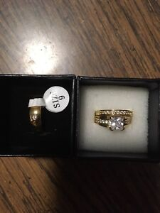 brand new...his & her rings.(cheap) $70