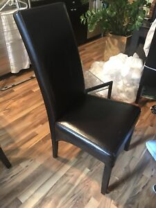 Hardwood espresso color dining table and 4x leather chairs