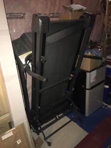 Treadmill. Practically brand new.