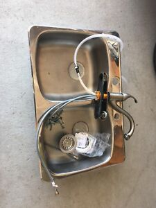 Double stainless steel sink and taps