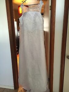 Never worn wedding dress size 22. $ 200