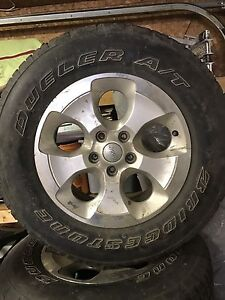 5 tires with rims