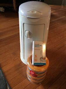 Munchkins brand diaper pail with lots of new refills!!