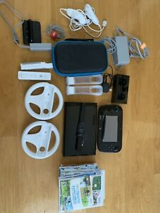 Wii U deluxe with games + Wii fit + more