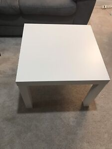 Two white Ikea Lack tables