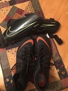 Size 10.5 soccer cleats and shin pads. Worn once.