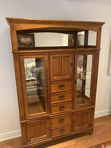 Hutch with pot lights and glass display doors.