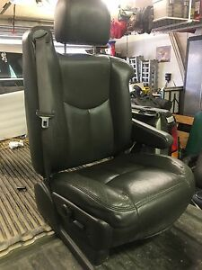 Full set of extended cab leather seats with wiring harness.