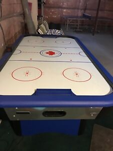 Air Hockey table with pucks