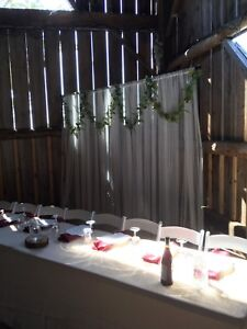 Wedding head table backdrop greenery and curtains