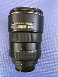 Nikon 17-55 f/2.8 with case and cap.