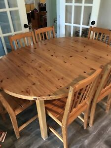 Solid pine IKEA dining room table and 6 chairs