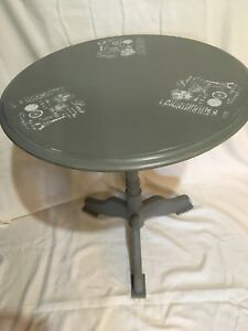 Round grey accent table
