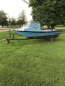 14 ft boat with trailer call 9028560866
