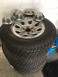 235/80R17 winter-studded tires on Chevy rims