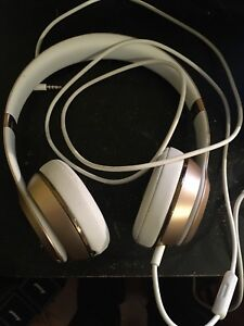 Gold Wireless Beats Solo3 headphones
