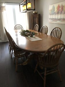 Solid oak dining table set, including 8 chairs and 4 leafs.