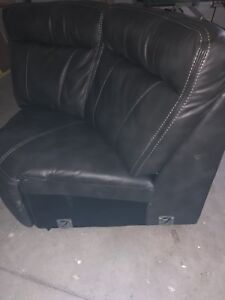 Dark Grey leather pieces of sectional couch