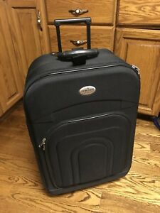 "Light weight large suitcase - 28"" T x 17"" W x 9.5"" D"