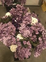 2 purple and white flower arrangements in pots