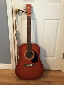 Acoustic guitar with accessories