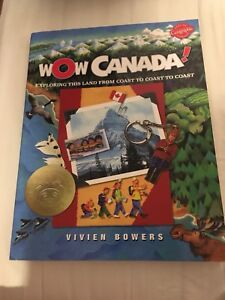 "Book titled ""Wow Canada"" Exploring the Land from Coast to Coast."