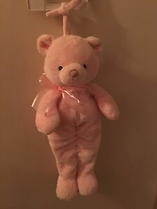 Baby pink bear that plays soothing music