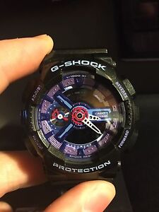 Blue and purple g-Shock 100 obo