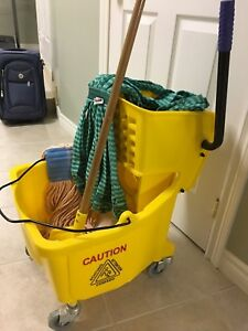 Janitorial wring pail and two new mops and handle
