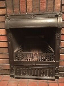 Circa 1910 cast iron fireplace insert.. Excellent condition.