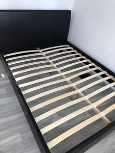 Queen bed frame with low profile box spring and mattress.