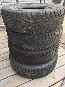 "4 Studded 14"" tires"