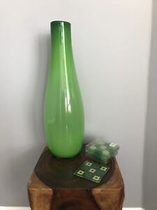 Tall bright green glass vase with coordinating coasters