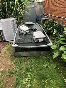 12 Ft aluminum boat and brand new trailer!