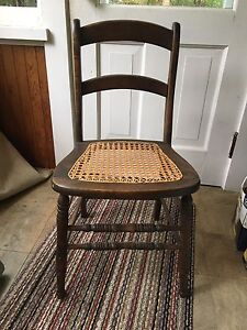 Two antique wicker bottom chairs.
