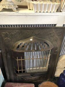 Vintage iron fireplace surround