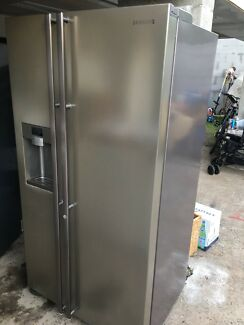 SILVER SAMSUNG double door fridge freezer with water and ice