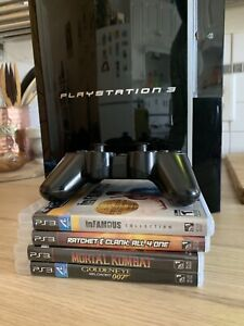 PS3 console + 2 controllers + 4 games