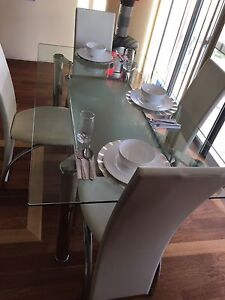 6 person glass dinning table with 6 leather chairs Carramar Wanneroo Area Preview