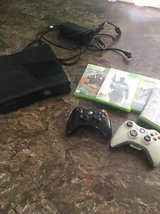 XBOX 360 S with games and two remotes