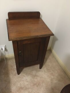 All timber antique bedside table