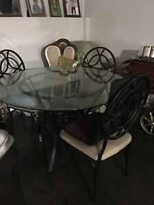 Beautiful glass table and wrought iron dining chairs