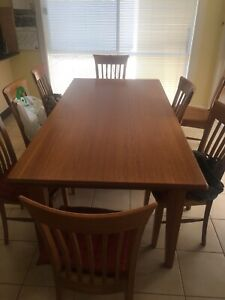 Solid timber dining table with 8 seats