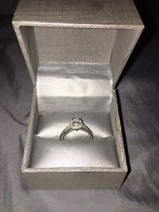 One lady's 14 karat white gold engagement ring. $1500 obo